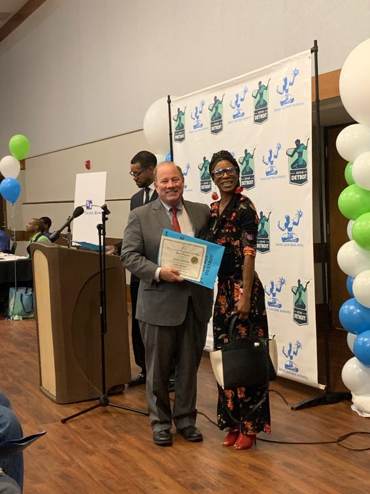 Tiffany Peterson, with Mayor Mike Duggan, was among the Detroit residents who received deeds to their homes at Thursday's event.