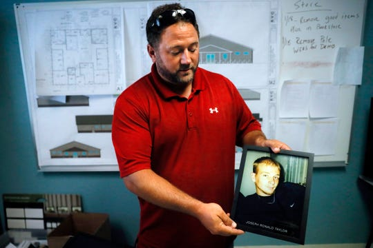 Justin Oyer, executive director at Warriors 4 Christ, an addiction recovery center and program, holds an image of his cousin Joseph Ronald Taylor, who died from opioid addiction, Wednesday, July 17, 2019, in Jackson, Ohio.