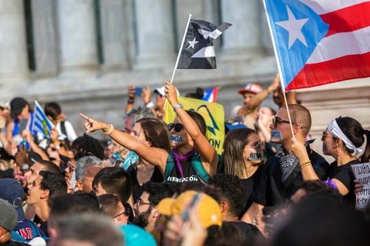 Demonstrators protest against governor Ricardo Rosello, in San Juan, Puerto Rico, Wednesday, July 17, 2019.