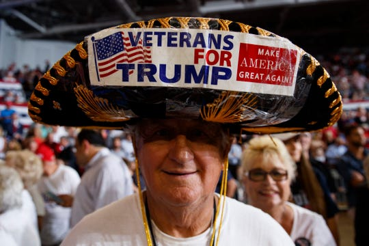 A supporter of President Donald Trump waits for the start of a campaign rally at Williams Arena in Greenville, N.C., Wednesday, July 17, 2019.