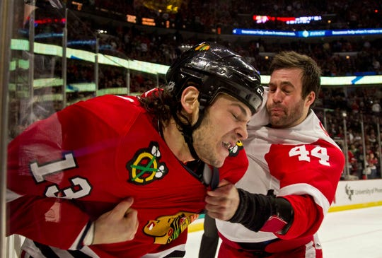 The Chicago Blackhawks' Daniel Carcillo and the Detroit Red Wings' Todd Bertuzzi fight during a game on Dec. 30, 2011.
