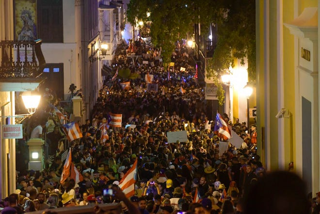 Demonstrators fill Cristo street in old San Juan, near the executive mansion to protest against governor Ricardo Rossello, in San Juan, Puerto Rico, Wednesday, July 17, 2019. Protesters are demanding Rossello step down for his involvement in a private chat in which he used profanities to describe an ex-New York City councilwoman and a federal control board overseeing the island's finance.