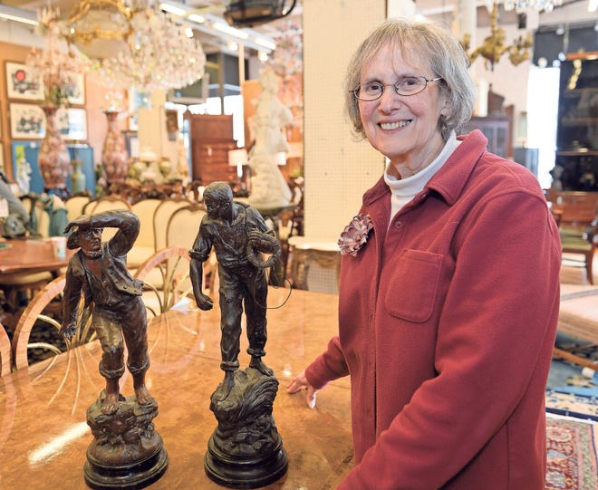 Gail Berkove with her two  sculptures.