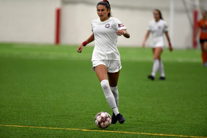 Motor City FC defender Malia Berkely controls the ball against the Detroit Sun  during the Milk Cup Final on Tuesday.