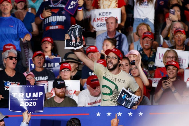 A protester calls out as President Donald Trump speaks at a campaign rally at Williams Arena in Greenville, N.C., Wednesday, July 17, 2019.