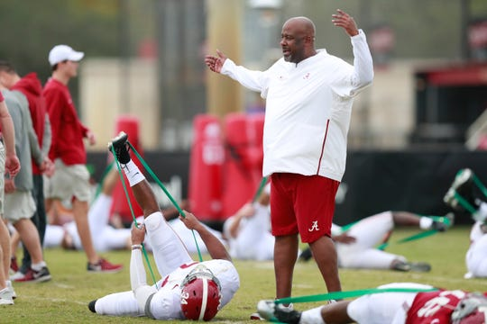 Mike Locksley, right, was an offensive coordinator at Alabama last season along with Josh Gattis before the two found new landing spots in the Big Ten.