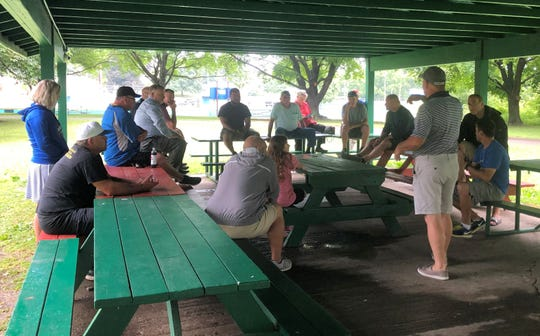 District 6 administrator Rick Kelley, standing, discusses plans for the New York State Little League 9-11 tournament July 17, 2019 next to the fields at Horseheads Little League.