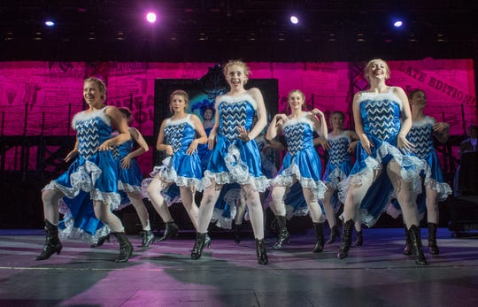 """Show girls in a scene during a dress rehearsal of the Warrick County School Corporation and the Warrick Public Education Foundation's 23rd summer musical """"NEWSIES."""" The play that usually only casts males will use both male and female cast members Tuesday, July 16, 2019."""
