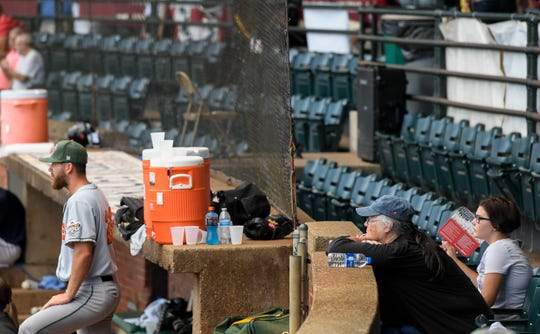 Debbie Parr, left, and Maraya Stuteville watch the game just outside of the netting that extends to the end of the dugout as the Evansville Otters play the Joliet Slammers at Bosse Field Wednesday, July 17, 2019.