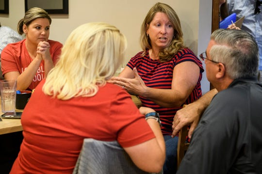 Gov. Eric Holcomb, far right to left, talks to Susan Fouts, Molly Adams and Sarah Stuart about funding public education during a meet-and-greet for his 2020 re-election campaign at Pie Pan Restaurant & Bakery in Evansville, Ind., Thursday, July 18, 2019.