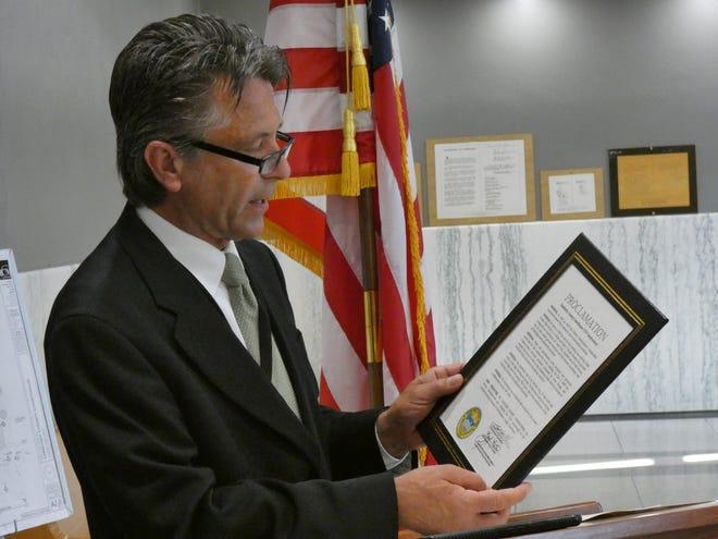 Sandusky County Commission Board President Scott Miller reads a proclamation celebrating the Sandusky County Courthouse's 175th anniversary.