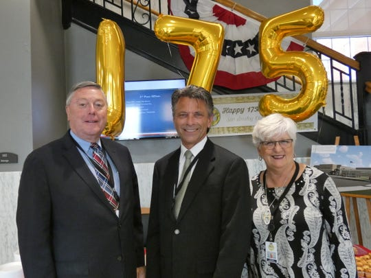 Sandusky County Commissioners, from left, Russ Zimmerman, Scott Miller and Kay Reiter celebrate the courthouse's 175th anniversary.