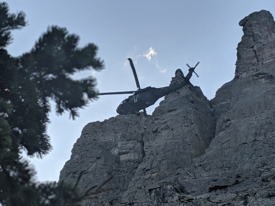 A search and rescue helicopter makes its way to airlift out an injured hiker Tuesday in Rocky Mountain National Park.