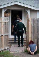 Lee County Sheriff Office deputies work the scene of a drug bust on Thursday on Broadway Avenue in unincorporated Fort Myers.