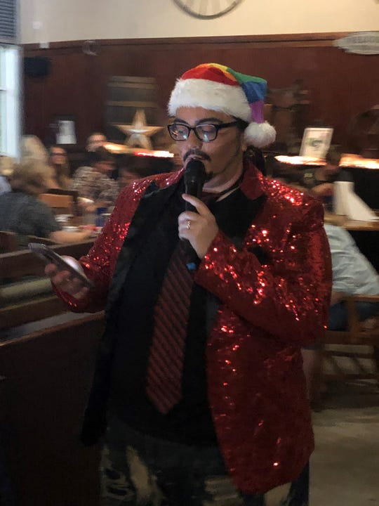 Dominique Sierra calls out the numbers as drag king Nick D'Cuple at Victory Lane Cafe in North Fort Myers.