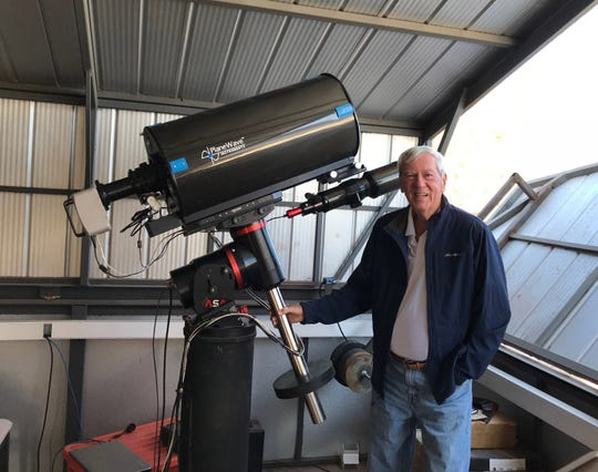 Ted Wolfe is pictured with his latest telescope set-up in Chile.