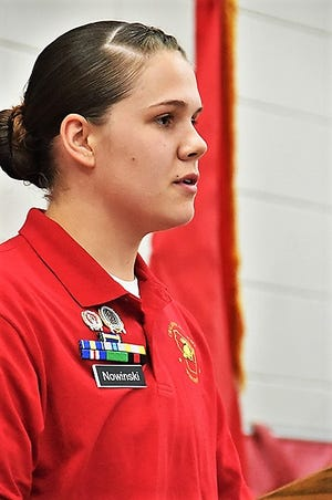 Taylor Nowinski, the Distinguished Honor Graduate of Wisconsin Challenge Academy Class 42 addresses her fellow cadets during a June 22 ceremony at Necedah High School.