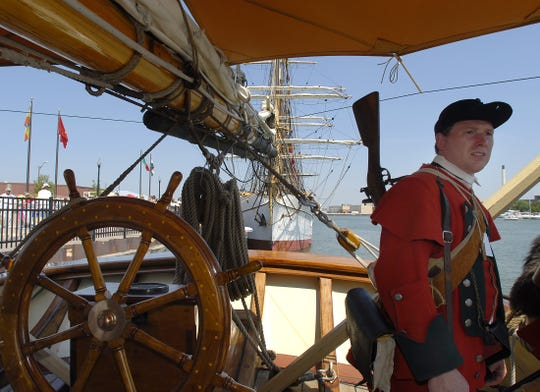 A French and Indian War light infantry re-enactor tours the Pride of Baltimore II during a previous Tall Ships festival in Green Bay. The ship is one of nine returning this year.