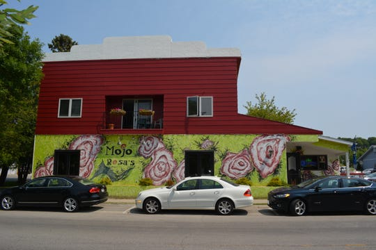 Local student Mackenzie Ellefson has been chosen to redo this mural on the side of Mojo Rosa's restaurant in Egg Harbor.