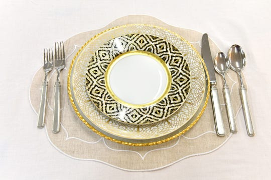 A dinnerware set by Robert Haviland Farahnaz at Shops of Provence.