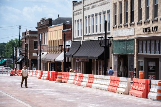Construction crews work on Trade Street in Greer Wednesday, July 17, 2019, as part of the city's revitalization of the downtown business district.