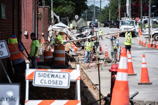 Construction crews work on Randall Street in Greer Wednesday, July 17, 2019, as part of the city's revitalization of the downtown business district.