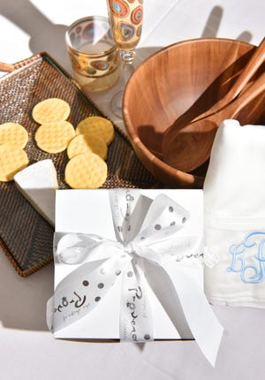 A wrapped gift with popular wedding gift items at Shops of Provence.