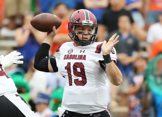 Nov 10, 2018; Gainesville, FL, USA;South Carolina Gamecocks quarterback Jake Bentley (19) throws the ball against the Florida Gators during the first quarter at Ben Hill Griffin Stadium. Mandatory Credit: Kim Klement-USA TODAY Sports