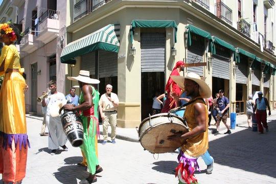 Street dancers perform in Old Havana.