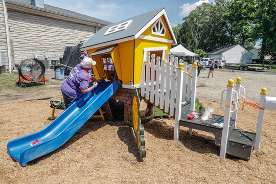Volunteers from the community, Finish Line Youth Foundation, Old Bethel United Methodist and KaBOOM!, put finishing touches on a playhouse for a new playground at Old Bethel United Methodist Church, 7995 E. 21st Indianapolis, on Thursday, July 18, 2019.
