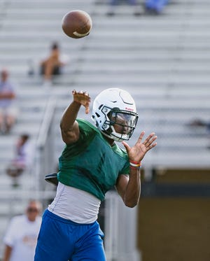 Lawrence North quarterback junior Donaven McCulley delivers a pass during a scrimmage Wednesday July 17, 2019, at Avon High School, Avon, IN.