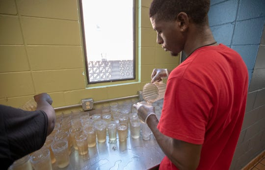Richard Viverette works on filling cups of ice with ginger ale during the dinner service at Wheeler Mission shelter for men, Indianapolis, Thursday, July 18, 2019. The shelter has plenty of water available as well, and more people have been using the facility during this period of high heat.