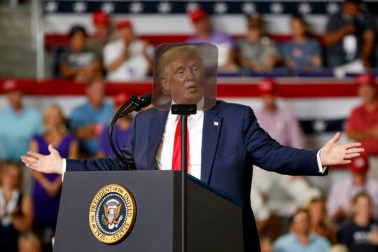 President Donald Trump is seen though a teleprompter as he speaks at a campaign rally at Williams Arena in Greenville, N.C., Wednesday, July 17, 2019. Trump alluded to last month's fatal shooting of a black man by a white South Bend police officer in criticisms of the city's mayor and presidential candidate Pete Buttigieg. (AP Photo/Carolyn Kaster)