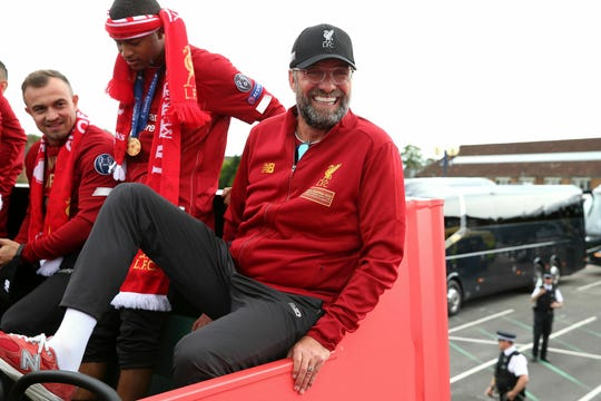 Liverpool soccer team manager Jurgen Klopp, rides an open top bus during the Champions League Cup Winners Parade in Liverpool, England, Sunday June 2, 2019.  Liverpool is champion of Europe for a sixth time after beating Tottenham 2-0 in the Champions League final played in Madrid Saturday.