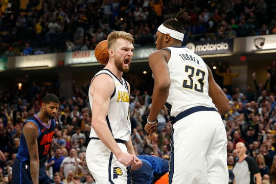 Pacers forward Domantas Sabonis (11) reacts after center Myles Turner (33) dunked the ball against the Oklahoma City Thunder during the fourth quarter at Bankers Life Fieldhouse.