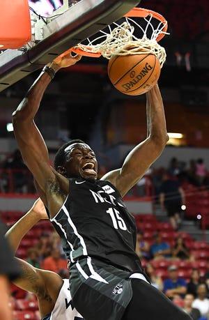 Jul 14, 2019; Las Vegas, NV, USA; Brooklyn Nets center Amida Brimah (15) dunks during the second half of an NBA Summer League game against the Minnesota Timberwolves at Thomas & Mack Center.