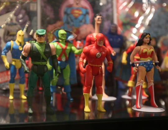 Priceless comic books and action figures line the display shelves of the Hall of Heroes Superhero Museum in Elkhart on Monday, July 8, 2019.