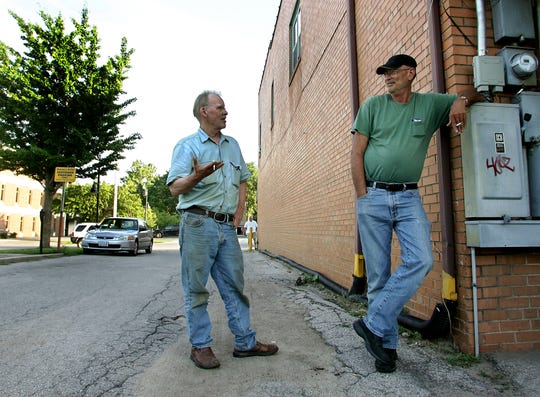 Chuck Aukema, left, and Jim Ochs chat while smoking outside George's Buffet in Iowa City on Friday, July 11, 2008. A statewide smoking ban went into effect on July 1, making it illegal to smoke in most indoor public spaces, including bars and restaurants.