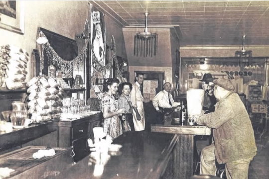 George Kanak (center, wearing tie) the founder of George's Buffet, is shown at the tavern in an undated photo.