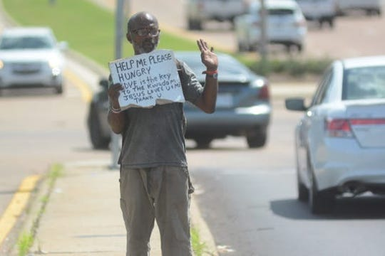 A homeless man asks for help at the intersection of I-55 and Lakeland Drive in Jackson. The ACLU of Mississippi is demanding cities such as Jackson remove ordinances that make panhandling illegal.