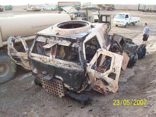 The remains of the vehicle veteran Jessie Thurston pulled three fellow servicemen from after an artillery shell struck the truck in Iraq rest on the sand on May 23, 2007.