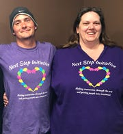 Adrian Ross, left, wears atNext Step Initiative T-shirt while meeting with co-founder Addie Arbach. After two false starts, Ross, 23, was preparing to go to rehab for drug addition.