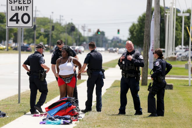 Lafayette Police question Shabrina Witherspoon of Indianapolis on Main Street near Sagamore Parkway after a report of shoplifting at Tippecanoe Mall, Wednesday, July 17, 2019, in Lafayette.