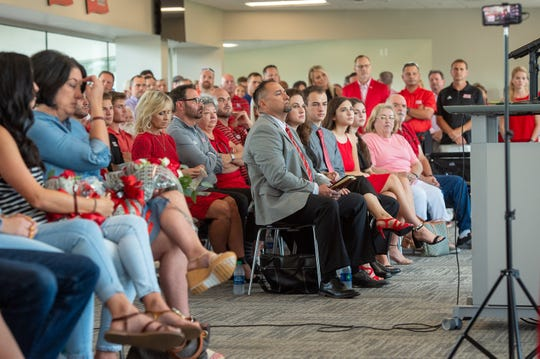 Matt Deggs sits with family members while waiting to be introduced last July as UL's new head baseball coach.