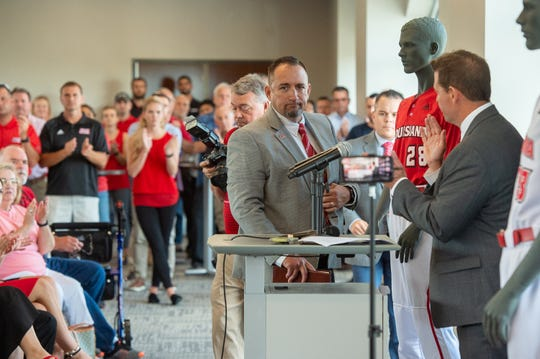 UL athletic director Bryan Maggard, right, introduces new Ragin' Cajuns baseball coach Matt Deggs.