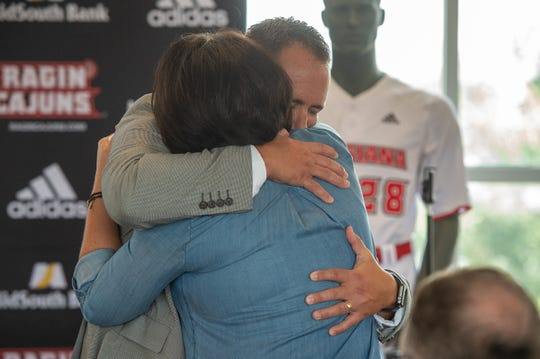 New UL baseball coach Matt Deggs shares an embrace with Colleeen Robichaux, the widow of late Ragin' Cajuns coach Tony Robichaux.