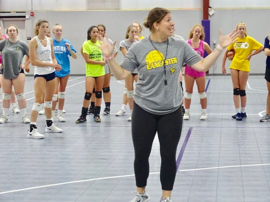First-year Lancaster volleyball coach Heather (Powers) Ingram gives instructions Wednesday during the Lady Gales' Volleyball Camp.