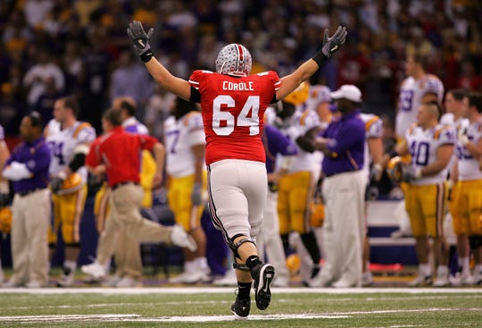 Jim Cordle of the Ohio State Buckeyes celebrates after Chris Wells scored a first-quarter touchdown against the Louisiana State University Tigers during the AllState BCS National Championship on January of 2008.