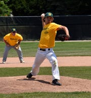 Patrick O'Brien (Class of 2013) pitches in a Howell alumni baseball game with Ken Pakkala (Class of 1985) playing second base.