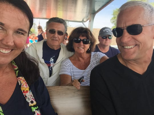 Rose and David Witt (front) enjoy Mackinac Island with Rose's parents Vic and Kathy Spaniola (back), who used to own Anthony's restaurant and ice cream parlor in Howell.
